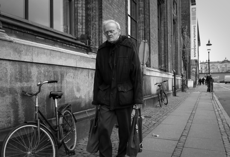 An older gentlemen carries his groceries home using his reusable canvas grocery bags. Denmark is considered to be the greenest country on Earth, and recycling is an important factor is helping the Danes achieve that status.