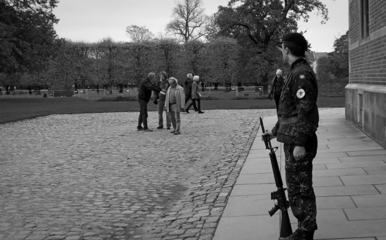 An armed guard keeps watch over tourists at the famous Rosenborg Castle. A staple to the hybrid Danish/Dutch architecture, the castle serves as a museum and art exhibit, and has maintained its current form since the year 1624.