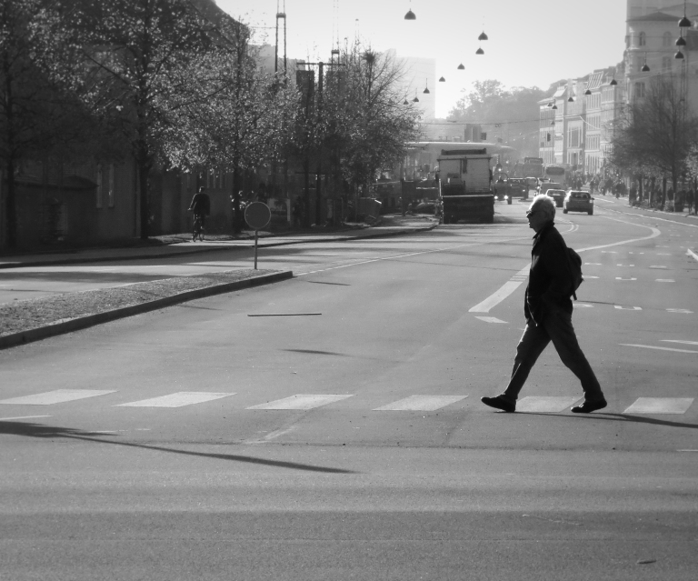 A lone Dane walks across an intersection outside of the Statens Museum for Kunst, a national art museum dedicated to Danish and Scandinavian art.