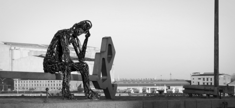 """Zinkglobal (or more often referred to as """"Metal Man"""") is a statue on Copenhagen's harbor. He represents a mindset that all citizens of Earth need to think globally about human's role in taking care of Earth's ecosystem. He, however, is often over-shadowed by his more popular sister, The Little Mermaid."""